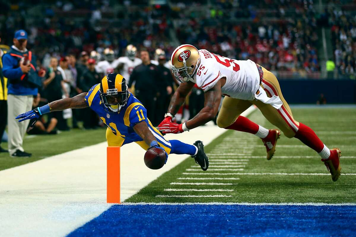 ST. LOUIS, MO - NOVEMBER 1: Tavon Austin #11 of the St. Louis Rams scores a touchdown past Ahmad Brooks #55 of the San Francisco 49ers in the second quarter at the Edward Jones Dome on November 1, 2015 in St. Louis, Missouri. (Photo by Dilip Vishwanat/Getty Images) *** BESTPIX ***