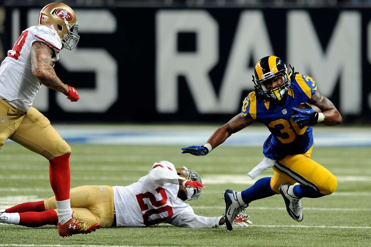 ST. LOUIS, MO - NOVEMBER 1: Todd Gurley #30 of the St. Louis Rams carries the ball fater fending off a tackle attempt from Kenneth Acker #20 of the San Francisco 49ers in the third quarter at the Edward Jones Dome on November 1, 2015 in St. Louis, Missouri. (Photo by Michael B. Thomas/Getty Images)