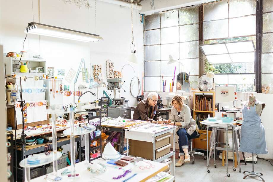 Acrylic jewelry artist Sarah Jane Hassler, center right, talks with a friend at Francisco Studios as part of Art Span's annual Open Studios in San Francisco, Calif., Sunday, November 1 2015. Photo: Jason Henry, Special To The Chronicle
