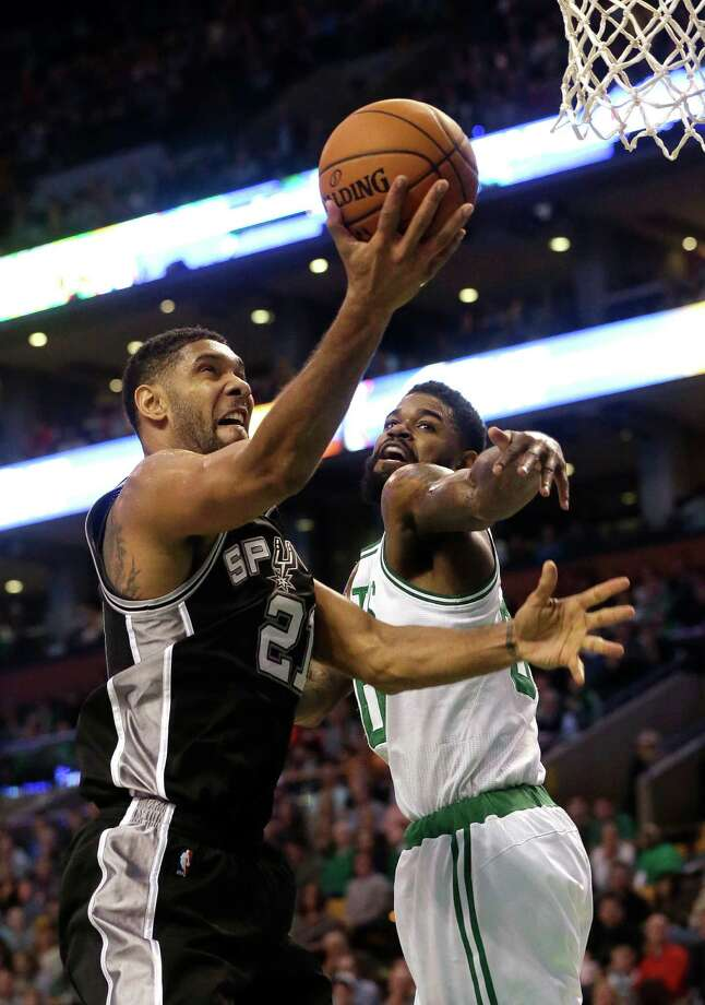 San Antonio Spurs forward Tim Duncan, left, drives toward the basket past Boston Celtics forward Amir Johnson, right, in the second quarter of an NBA basketball game, Sunday, Nov. 1, 2015, in Boston. Photo: Steven Senne, Associated Press / AP