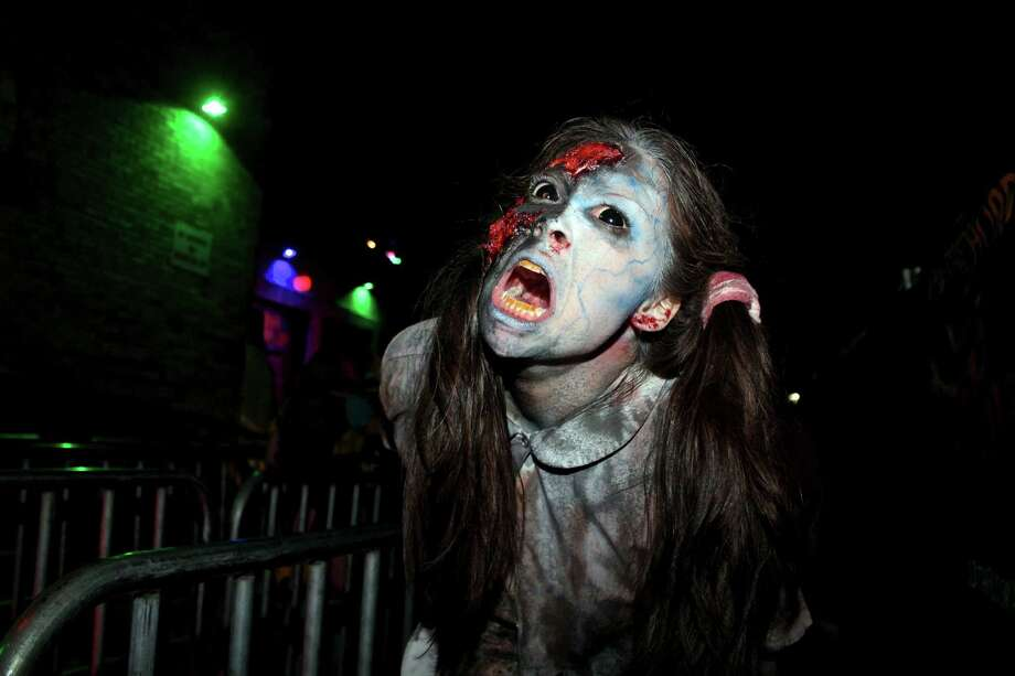 Costumed Halloween thrill seekers hit the 13th Floor Haunted House Saturday night, Oct. 31, 2015, for what has become a favorite spooky tradition — trick-or-treating to start off the night and then a good old fashioned scare at a haunted house. Photo: By Yvonne Zamora, For MySA.com,