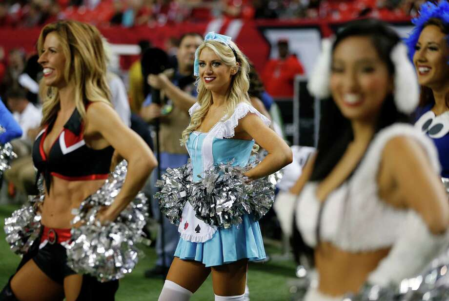 Atlanta Falcons cheerleaders dressed in Halloween costume perform before the first of an NFL football game between the Atlanta Falcons and the Tampa Bay Buccaneers, Sunday, Nov. 1, 2015, in Atlanta. (AP Photo/John Bazemore) Photo: John Bazemore, Associated Press / AP