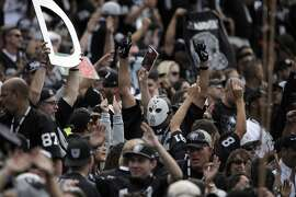 The Raiders fans cheer after a second quarter touchdown by Michael Crabtree (15) as the Oakland Raiders played the New York Jets at O.co Coliseum in Oakland, Calif., on Sunday, November 1, 2015.