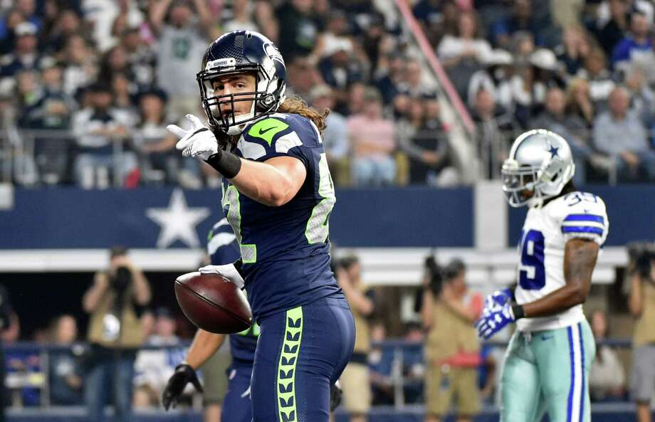 Seattle Seahawks tight end Luke Willson celebrates his touchdown against the Dallas Cowboys in the first half of an NFL football game Sunday, Nov. 1, 2015, in Arlington, Texas. Photo: Michael Ainsworth, Associated Press / FR171389 AP