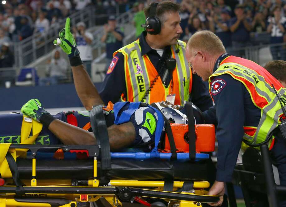 ARLINGTON, TX - Ricardo Lockette #83 of the Seattle Seahawks waves to fans while being carted off the field in the second quarter at AT&T Stadium on November 1, 2015 in Arlington, Texas. (Photo by Tom Pennington/Getty Images)