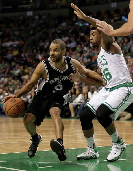San Antonio Spurs guard Tony Parker, of France, left, drives toward the basket past Boston Celtics guard Marcus Smart, right, in the first quarter of an NBA basketball game, Sunday, Nov. 1, 2015, in Boston. (AP Photo/Steven Senne) Photo: Steven Senne, STF / Associated Press / AP