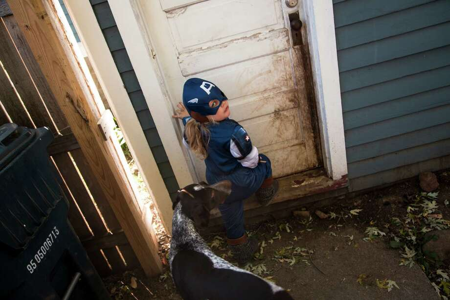 Aliceana Belling plays in her Captain America costume at her home in Fond Du Lac, Wis. Aliceana and her parents, Brittany and A.J. Belling, make up one of many families that are fed up with the strict princess dresses for girls, action figures for boys stereotyping that they say still pervades children's toys, clothes, costumes and other merchandise. Photo: Darren Hauck /New York Times / NYTNS