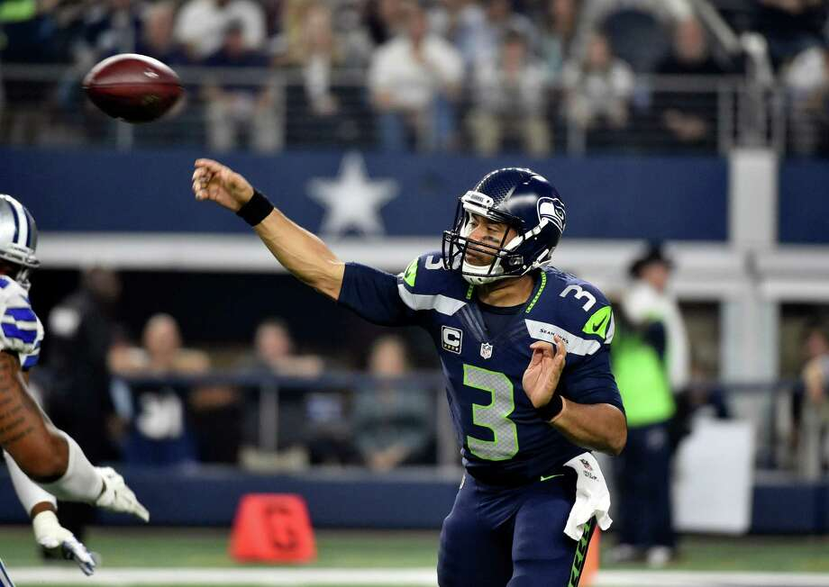 Quarterback: B-It's difficult to evaluate Russell Wilson this year. He's playing behind an underperforming offensive line that's often left with him little time to throw. But the fact remains he's taken more sacks -- an NFL-high 31 -- than he should have and too often missed open receivers because he left the pocket early.He also has nine touchdowns to six interceptions, a ratio that isn't great, given the four-year, $87.5 million contract extension he signed at the end of July. Wilson is being paid like an elite quarterback, so he's held to a higher standard. He's completing almost 70 percent of his passes, but there's plenty for him to improve on in the season's second half. Photo: Michael Ainsworth, Associated Press / FR171389 AP