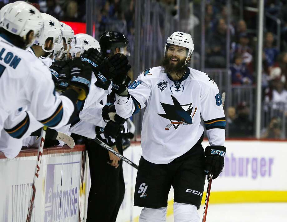 San Jose Sharks defenseman Brent Burns is congratulated as he passes the team box after scoring a goal against the Colorado Avalanche in the third period of an NHL hockey game Sunday, Nov. 1, 2015, in Denver. San Jose won 4-3. (AP Photo/David Zalubowski) Photo: David Zalubowski, Associated Press