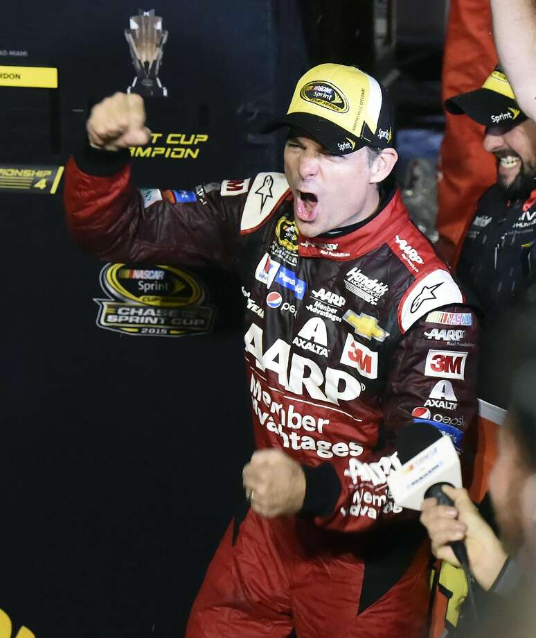 Jeff Gordon, right, celebrates with his team after winning the NASCAR Sprint Cup Series auto race at Martinsville Speedway in Martinsville, Va., Sunday, Nov. 1, 2015. (AP Photo/Don Petersen) Photo: Don Petersen, Associated Press
