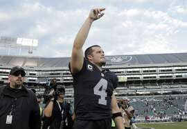 Raiders quarterback Derek Carr (4) acknowledges the fans after Oakland defeated the New York Jets 34-20 at O.co Coliseum in Oakland, Calif., on Sunday, November 1, 2015.