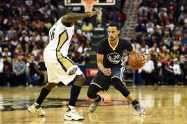 NEW ORLEANS, LA - OCTOBER 31:  Stephen Curry #30 of the Golden State Warriors works against Toney Douglas #16 of the New Orleans Pelicans during the second half of a game at the Smoothie King Center on October 31, 2015 in New Orleans, Louisiana. NOTE TO USER: User expressly acknowledges and agrees that, by downloading and or using this photograph, User is consenting to the terms and conditions of the Getty Images License Agreement.  (Photo by Stacy Revere/Getty Images)