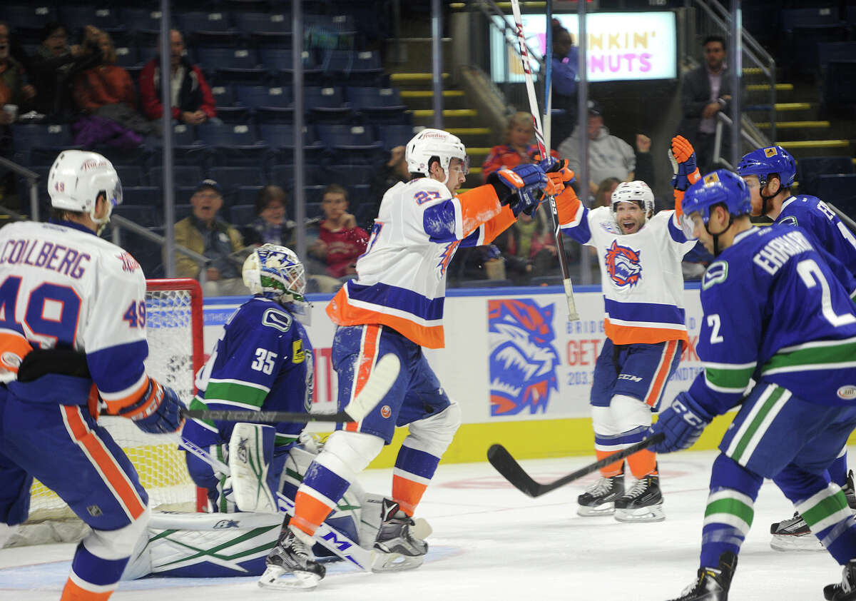 Sound Tiger Justin Vaive celebrates after scoring a power play goal during the closing minutes of the second period of his team's AHL game with the Utica Comets at the Webster Bank Arena in Bridgeport, Conn. on Sunday, November 1, 2015.