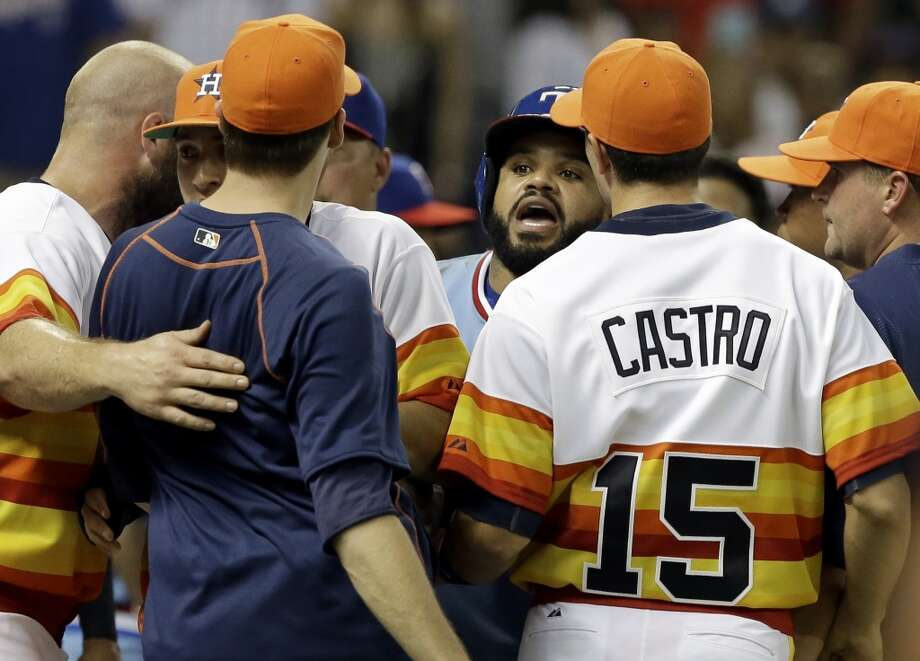Texas Rangers' Prince Fielder, center, confronts Houston Astros' Jed Lowry, in navy blue, after both benches cleared in the ninth inning of a baseball game Saturday, July 18, 2015, in Houston. The confrontation took place after Astros catcher Hank Conger and Rangers' Rougned Odor exchanged words. (AP Photo/Pat Sullivan) Photo: Pat Sullivan, Associated Press