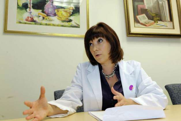 Dr. Amy Barton Pai, who is involved in research regarding the damage that common pain pills can cause to kidneys, at the Albany College of Pharmacy on Friday Oct. 16, 2015 in Troy, N.Y. (Michael P. Farrell/Times Union) Photo: Michael P. Farrell / 10033784A