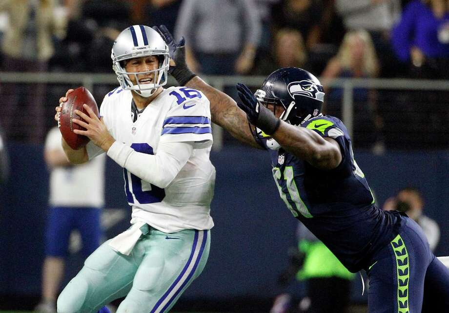Matt Cassel (left), about to be sacked by Bruce Irvin, dropped to 0-2 as the starting quarterback. Photo: Brandon Wade /Associated Press / FR168019 AP