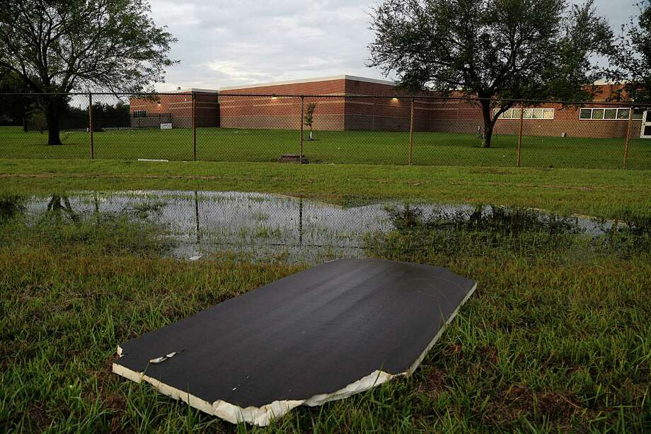 Scattered debris remains evident Sunday at La Porte ISD's Jennie Reid Elementary School, which experienced the worst damage from Saturday's storms.  Photo: James Nielsen, Staff / © 2015  Houston Chronicle