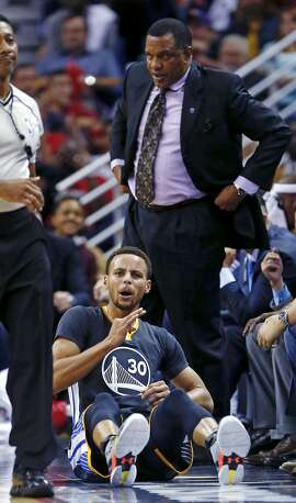 Golden State Warriors guard Stephen Curry (30) reacts after being fouled while sinking a three-point shot in the second half of an NBA basketball game against the New Orleans Pelicans in New Orleans, Saturday, Oct. 31, 2015. Behind is New Orleans Pelicans head coach Alvin Gentry. The Warriors won 134-120. (AP Photo/Gerald Herbert)