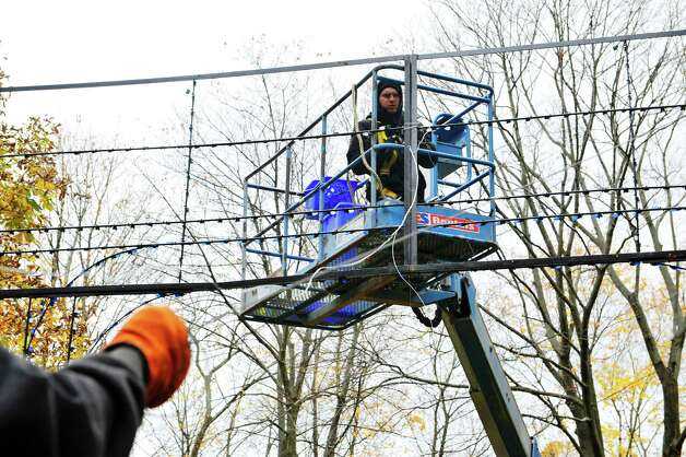 Police Athletic League volunteer David Czamara works with other volunteers as they worked to set up  more than 125 illuminated displays and scenes for the 19th Annual Price Chopper Capital Holiday Lights on Sunday, Nov. 1, 2015, in Washington Park in Albany, N.Y.  The lights display opens to the public on November 27th.    (Paul Buckowski / Times Union) Photo: PAUL BUCKOWSKI / 00034006A
