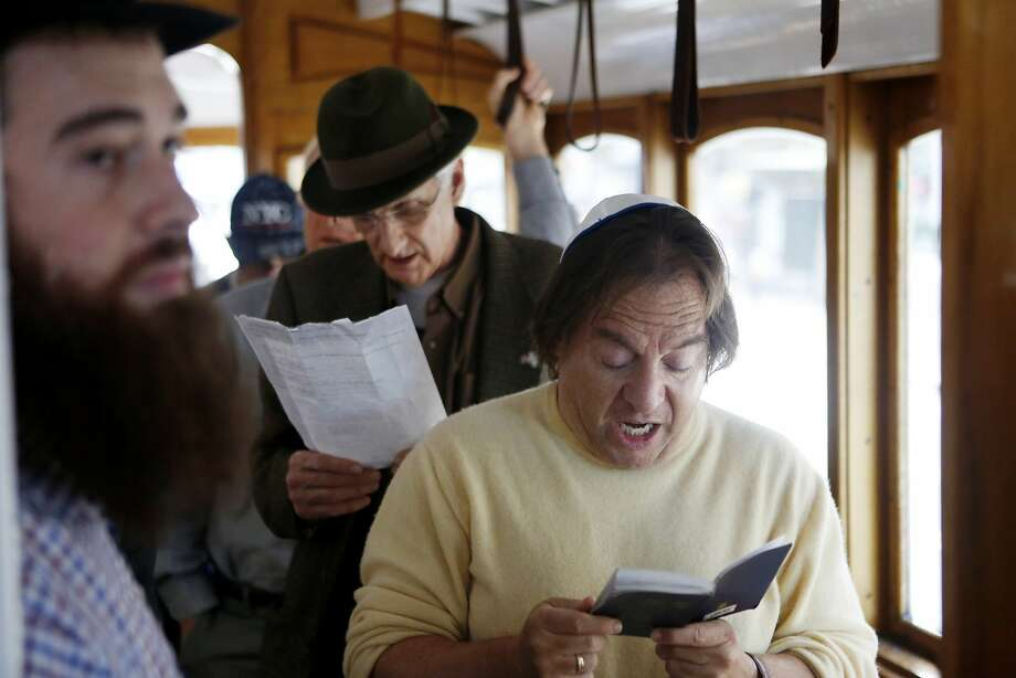 Len Yaffe leads the kaddish prayers on the Mitzvah Cable Car in downtown San Francisco. The kaddish are recited at the end of prayer services to honor those who have passed. Sons say the Kaddish to honor their mother or father for the first eleven months after their passing and every year on the anniversary. Photo: Kathleen Duncan, The Chronicle