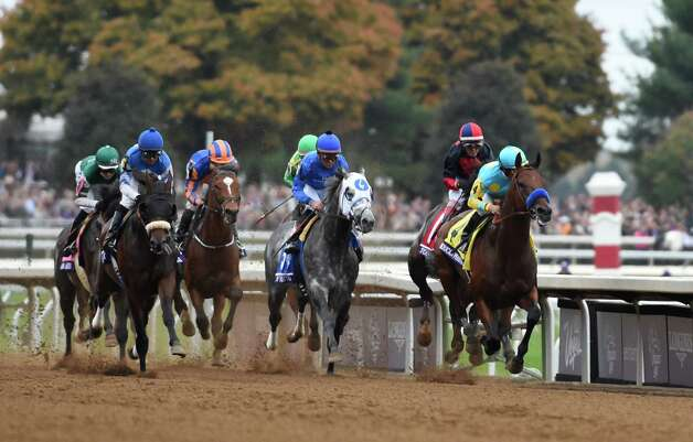 American Pharoah with Victor Espinoza in the saddle goes past the clubhouse the first time as he goes on to win  the Breeders' Cup Classic in track record time Oct. 31, 2015 at Keeneland Race Track in Lexington, KY  (Skip Dickstein/Times Union) Photo: SKIP DICKSTEIN