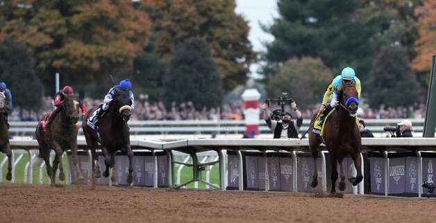 American Pharoah with Victor Espinoza in the saddle opens up on the field to win  the Breeders' Cup Classic in track record time Oct. 31, 2015 at Keeneland Race Track in Lexington, KY  (Skip Dickstein/Times Union) Photo: SKIP DICKSTEIN
