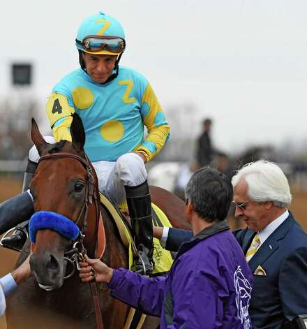 Jockey Victor Espinoza sits atop American Pharoah and and is greeted by trainer Bob Baffert, right,  after winning the Breeders' Cup Classic in track record time Oct. 31, 2015 at Keeneland Race Track in Lexington, KY  (Skip Dickstein/Times Union) Photo: SKIP DICKSTEIN