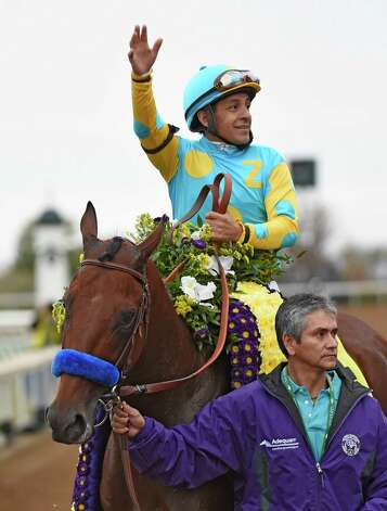 Jockey Victor Espinoza sits atop American Pharoah waves to the crowd after winning the Breeders' Cup Classic in track record time Oct. 31, 2015 at Keeneland Race Track in Lexington, KY  (Skip Dickstein/Times Union) Photo: SKIP DICKSTEIN