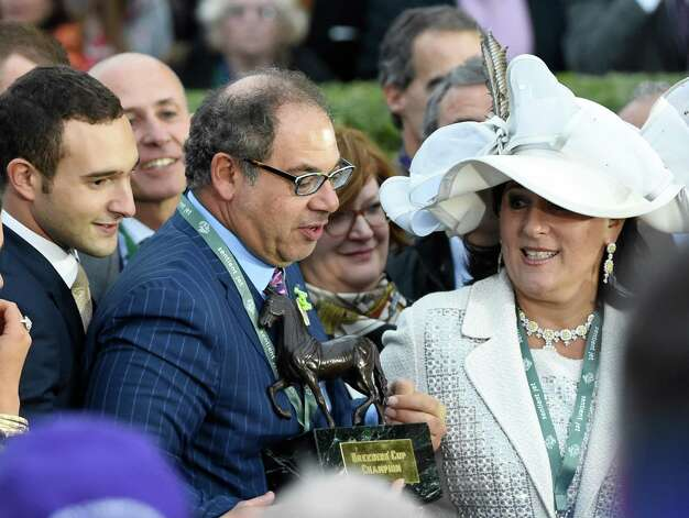 Ahmet Zayat, center accepts the winner's trophy after American Pharoah won the Breeders' Cup Classic in track record time Oct. 31, 2015 at Keeneland Race Track in Lexington, KY.  Zayat is flanked by his wife Joanne, right and son Justin, left. (Skip Dickstein/Times Union) Photo: SKIP DICKSTEIN