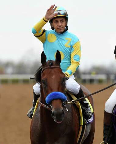 Jockey Victor Espinoza sits atop American Pharoah and waves to the crowd after winning the Breeders' Cup Classic in track record time Oct. 31, 2015 at Keeneland Race Track in Lexington, KY  (Skip Dickstein/Times Union) Photo: SKIP DICKSTEIN