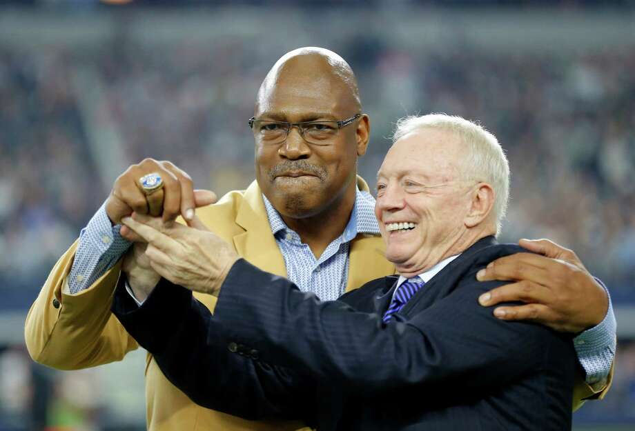 Hall of Famer Charles Haley is presented his HOF ring by Dallas Cowboys team owner Jerry Jones, right, on the field during a presentation in the first half of an NFL football game against the Seattle Seahawks  Sunday, Nov. 1, 2015, in Arlington, Texas. (AP Photo/Brandon Wade) Photo: Brandon Wade, FRE / Associated Press / FR168019 AP