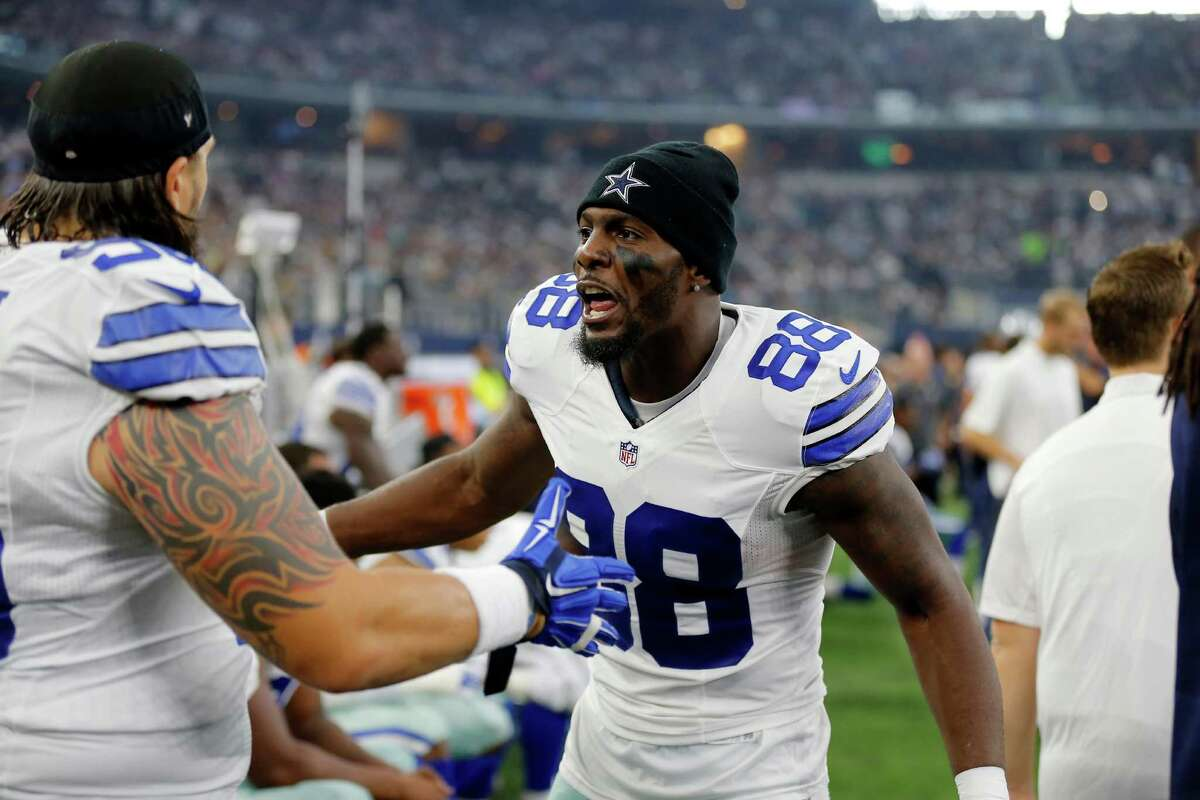 Dallas Cowboys' Dez Bryant (88) talks with Nick Hayden, left, on the sideline during the first half of an NFL football game against the Seattle Seahawks Sunday, Nov. 1, 2015, in Arlington, Texas. (AP Photo/Brandon Wade)