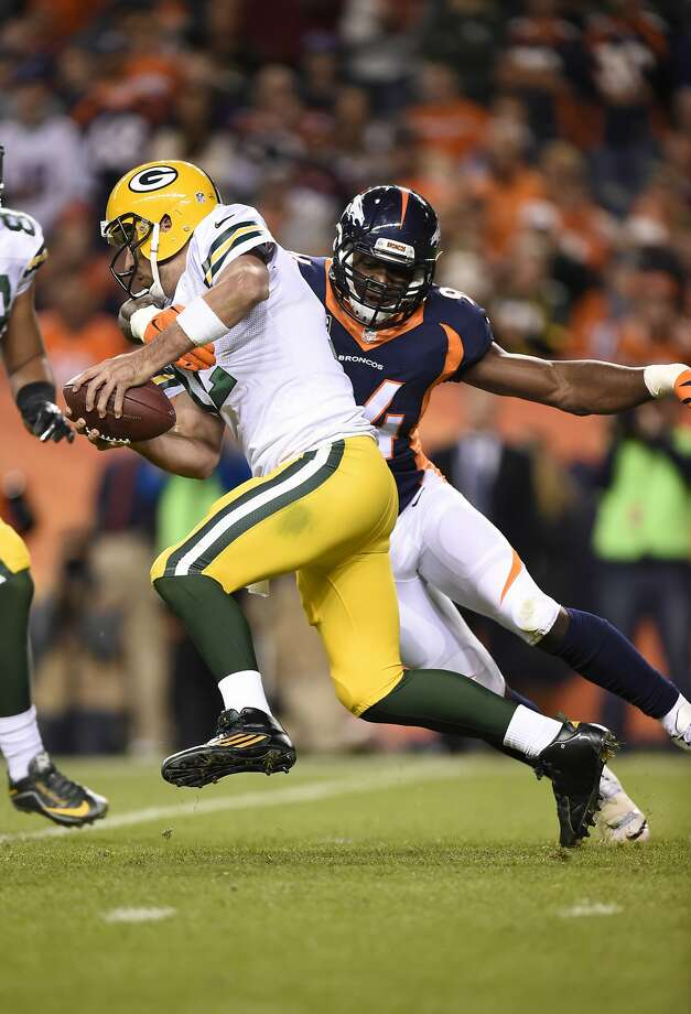 DeMarcus Ware sacks Aaron Rodgers in the fourth. Photo: Mark Reis, McClatchy-Tribune News Service
