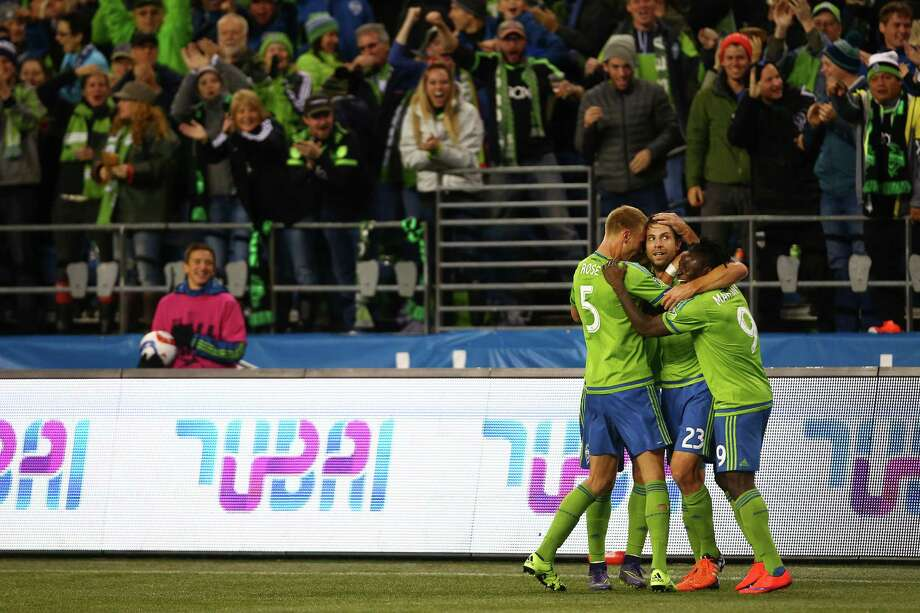 Seattle's Andy Rose (left), Andreas Ivanschitz (center) and Obafemi Martins (right) celebrate Ivanschitz's goal in the second half of game one of the MLS Conference Semifinals, Sunday, Nov. 1, 2015 at CenturyLink Field.  The Sounders won 2-1. Photo: GENNA MARTIN, SEATTLEPI.COM / SEATTLEPI.COM