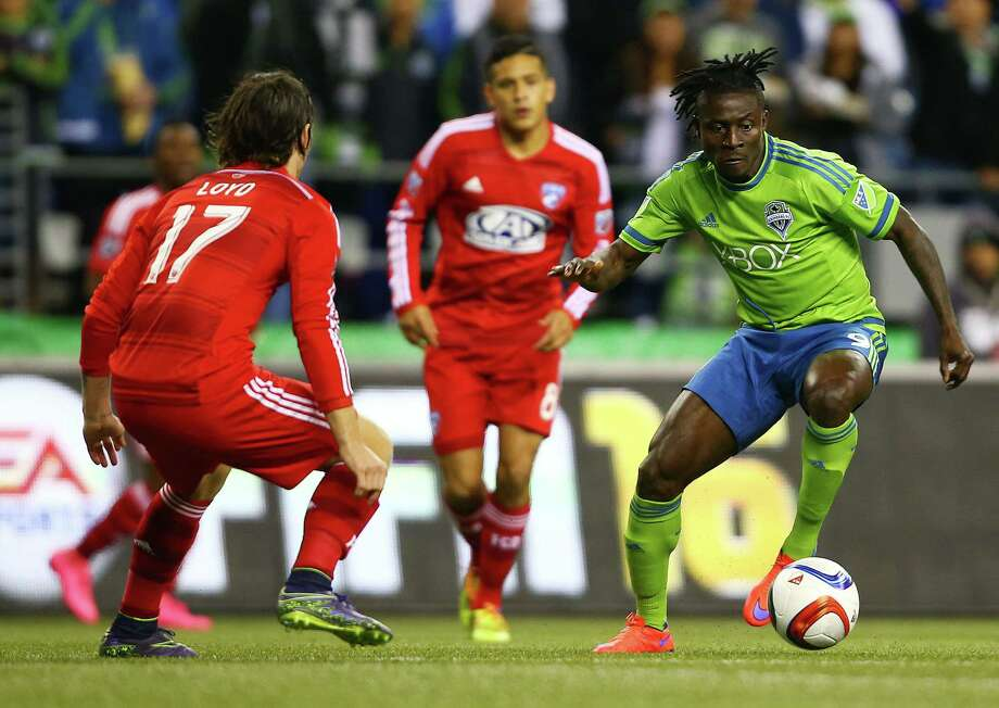 Seattle's Obafemi Martins drives with the ball as Dallas' Zack Loyd defends in the first half of game one of the MLS Conference Semifinals, Sunday, Nov. 1, 2015 at CenturyLink Field. Photo: GENNA MARTIN, SEATTLEPI.COM / SEATTLEPI.COM