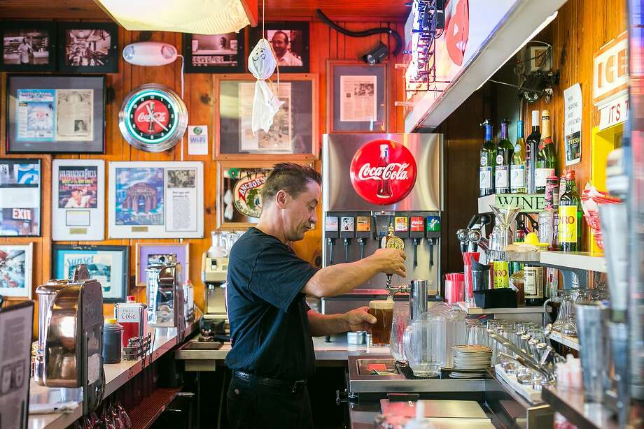 Bruce Chapman pours a beer from the single tap at It's Tops Coffee Shop. Photo: Jen Fedrizzi, Special To The Chronicle