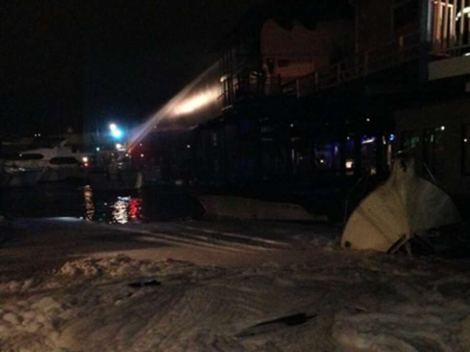 Firefighters used foam to put out a fire at a Lake Union marina on Monday, Nov. 2, 2015. Seattle Fire Department photo.