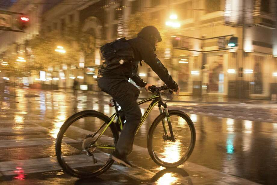 A bicyclist makes his way through the rain in San Francisco early Monday morning November 2, 2015. Photo: SF Gate / Douglas Zimmerman