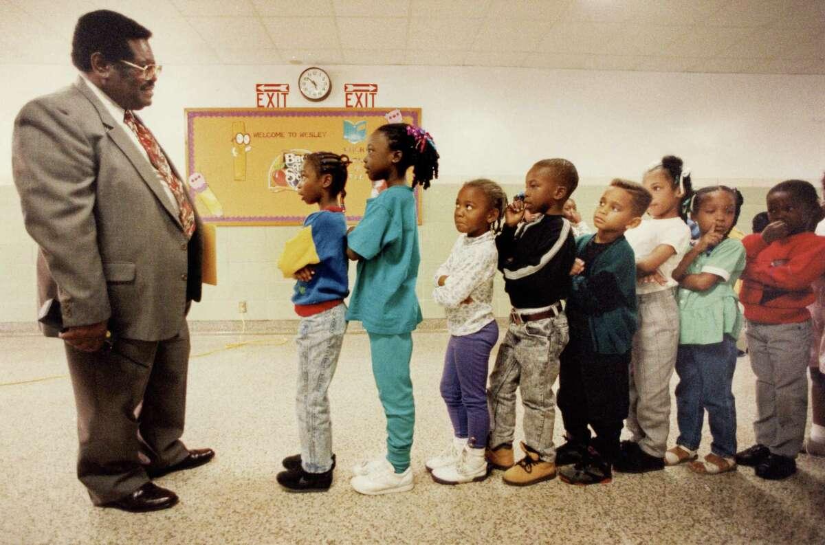 Principal Thaddeus Lott talks to Wesley Elementary first-graders in 1992.