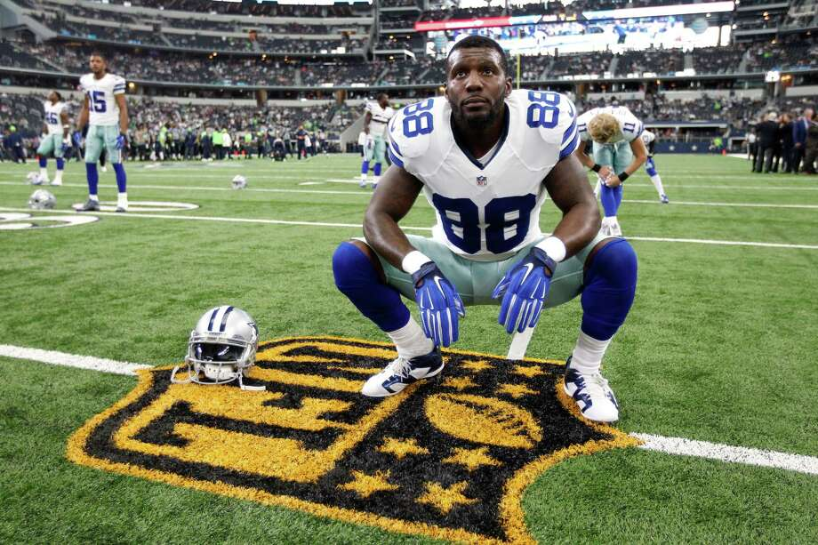 Dallas Cowboys' Dez Bryant (88) stretches on the gold NFL logo before a football game against the Seattle Seahawks Sunday, Nov. 1, 2015, in Arlington, Texas. (AP Photo/Brandon Wade) Photo: Brandon Wade, Associated Press / FR168019 AP