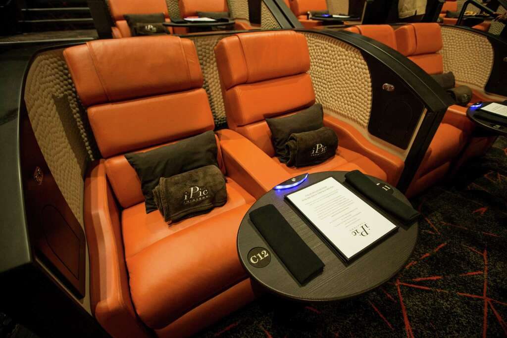 A pair of the reclining seats in one of the screening rooms at iPic Theaters. & Viewing pods pillows u0027ninjau0027 waiters at iPic Theaters - Houston ... islam-shia.org
