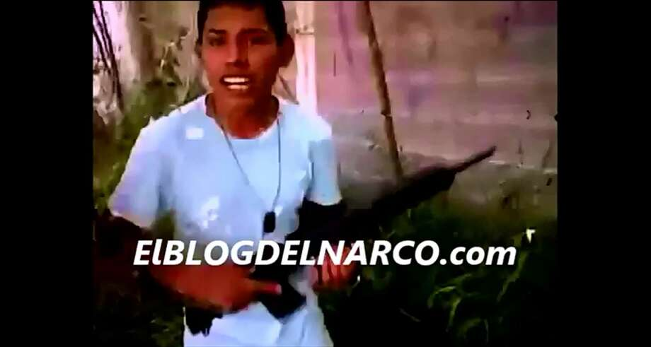 "A video published by El Blog Del Narco shows young men who are purported ""sicarios"" for the Gulft Cartel holding assault weapons. Photo: Screenshot/El Blog Del Narco"