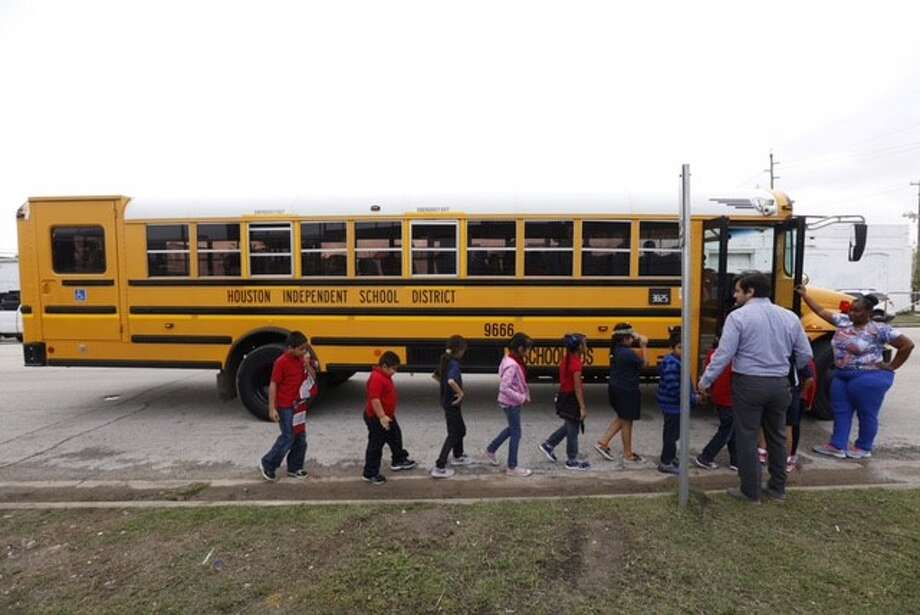 Two students were taken to the hospital after an HISD bus crash. The students from Sherman Elementary School were en-route to a field trip. Photo: Cody Duty