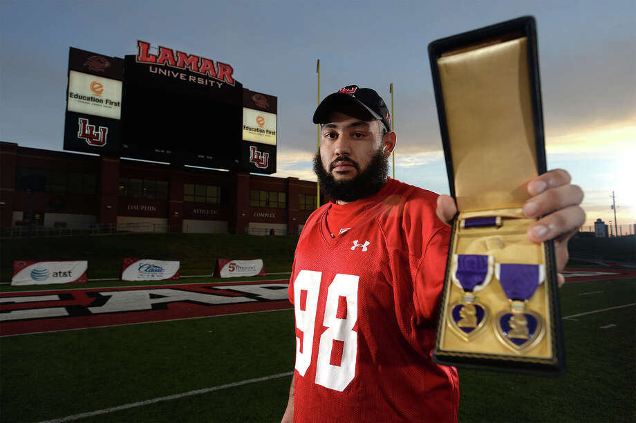 Lamar's Marcus Abbott holds the Purple Heart, right, that he received after being hit by an improvised explosive device in Kandahar Afghanistan in 2013. Abbott's Uncle's Purple Heart is also shown.  Photo taken Photo taken Wednesday, October 29, 2015  Guiseppe Barranco/The Enterprise Photo: Guiseppe Barranco, Photo Editor