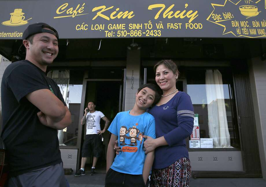 The Do family, owners of Cafe Kim Thuy in Oakland (from left): son Tony, father Truong, son John and mom Kim Thuy. Photo: Liz Hafalia, The Chronicle