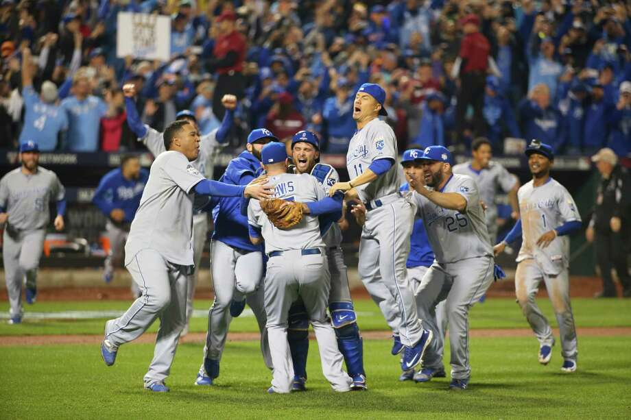 The Kansas City Royals celebrate the team winning the World Series against the New York Mets at Citi Field in New York, Nov. 2, 2015. The Royals beat the Mets 7-2 in Game 5 to claim the World Series title. (Chang W. Lee/The New York Times) Photo: CHANG W. LEE, STF / New York Times / NYTNS