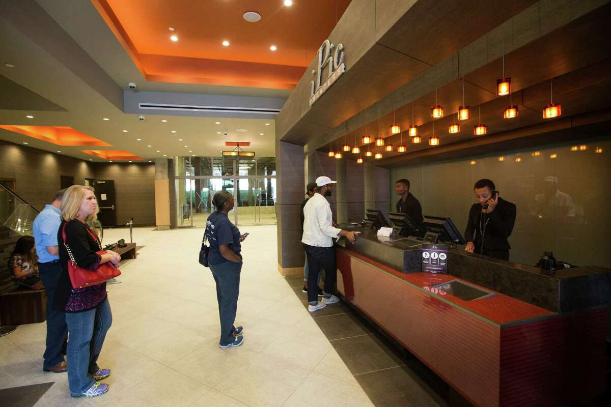 Customers line up for tickets at iPic theater at River Oaks District.