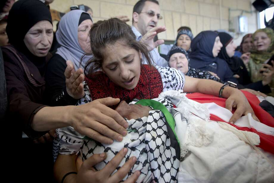 Mohammed Shamasneh is mourned at his funeral. The army says Israeli soldiers killed him after an attempted stabbing. Photo: Majdi Mohammed, Associated Press