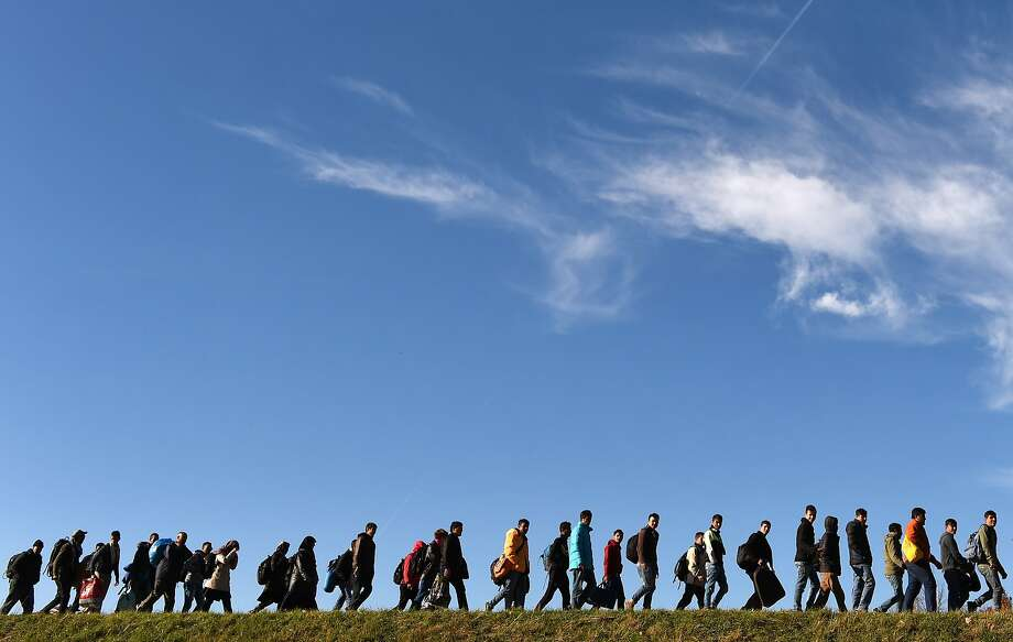 Migrants trek to a registration center in the Bavarian village of Simbach in southern Germany after arriving from Austria. Photo: Christof Stache, AFP / Getty Images