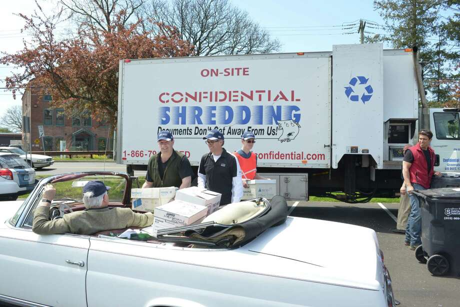 "Last year's Spring Earth Day, held recently in the Island Beach parking lot, more than 10,500 pounds of paper, equivalent to 90 trees, was shredded, according to the Greenwich Green & Clean team and those representing the Greenwich Recycling Advisory Board. The goal of the event was to encourage proper shredding to prevent identity theft while also ensuring that shredded paper is recycled to save trees. ""Our sponsors are local businesses who see the need for, and the benefits of, on-site document destruction and recycling,"" said Mary Hull of Greenwich Green & Clean, who helped organized the event. Sally Davies, Chair of Greenwich Recycling Advisory Board, added, ""This is our third shredding event, dubbed 'Earth Shred' to convey that keeping paper in the cycle - tree, paper, shreds, recycling, new paper products - saves trees and protects the environment."" The event was sponsored by The First Bank of Greenwich and Santaguida Sanitation. Above, volunteers from First Bank unload boxes of papers to be shredded. Photo: Christopher Semmes For Greenwich / Christopher Semmes For Greenwich / Greenwich Citizen"